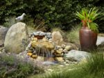 A waterfall and pond